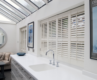 Plantation Shutters Vs Conventional Window Treatments - White Bathroom Shutters