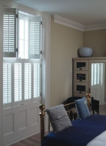 Tier-on-tier folding window shutters