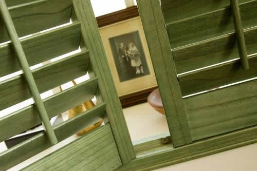 Plantation shutters with green stain